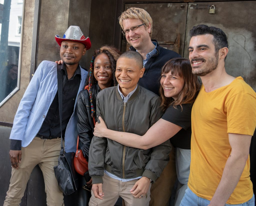 """The leads and filmmakers of """"Unsettled"""" Junior Mayema -- in the red, white, and blue cowboy hat -- is a client of the Guardian Group."""