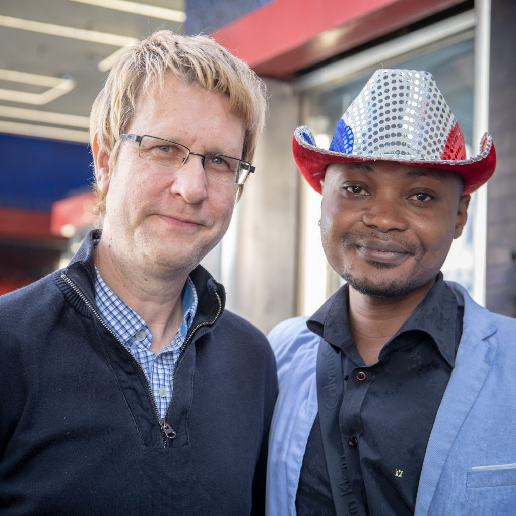 Filmmaker Tom Shepherd (left) with Guardian Group client Junior Mayema